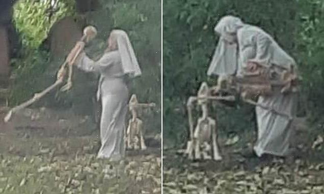 Woman dressed as a nun is seen dancing with skeletons in Hull cemetery